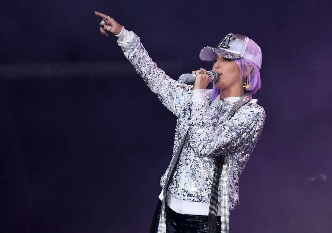 See Miley Cyrus Perform 'On a Roll' and 'Head Like a Hole' at Glastonbury
