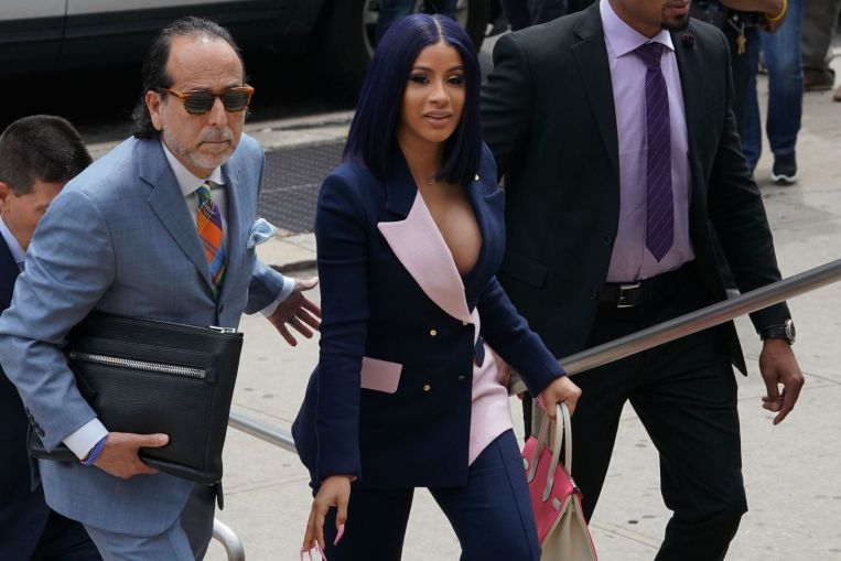Rapper Cardi B pleads not guilty to charges in New York strip club fight