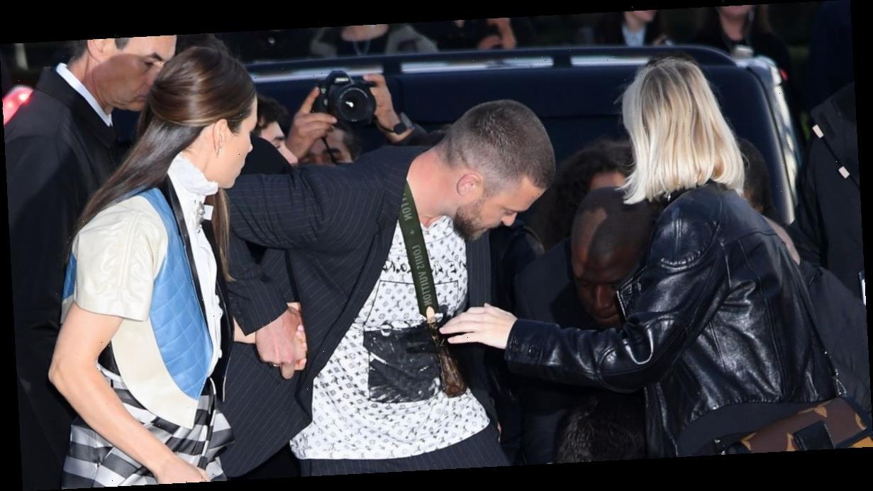 Justin Timberlake pulled to the ground by prankster at Paris Fashion Week