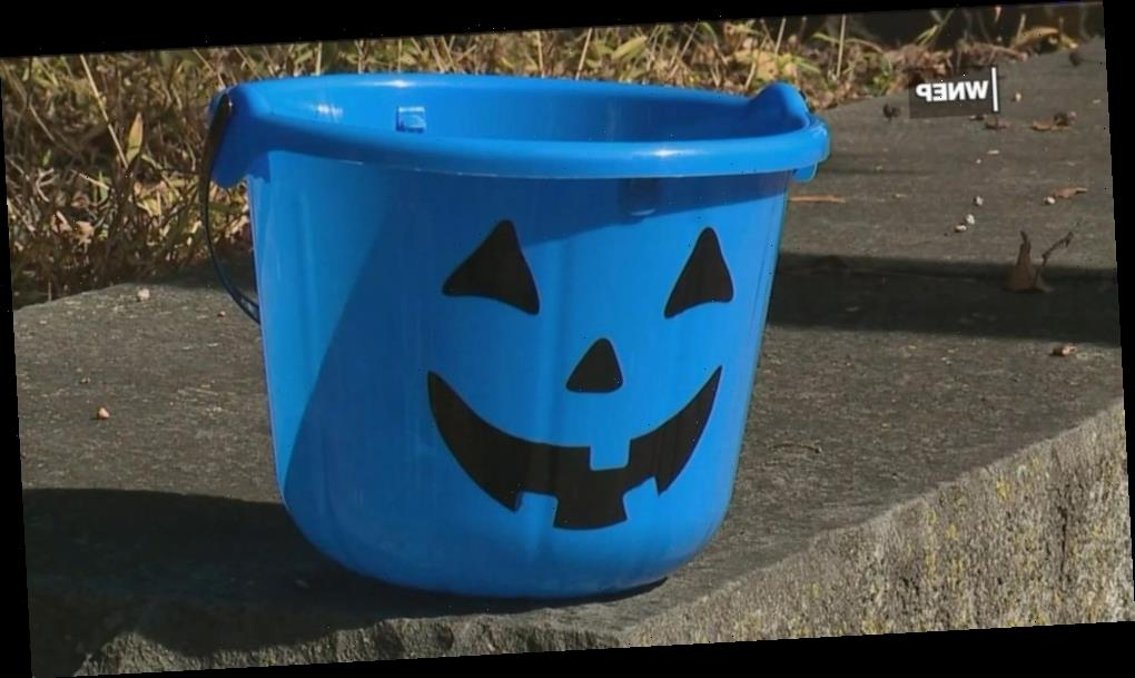 Parents raise awareness for autism with blue Halloween buckets