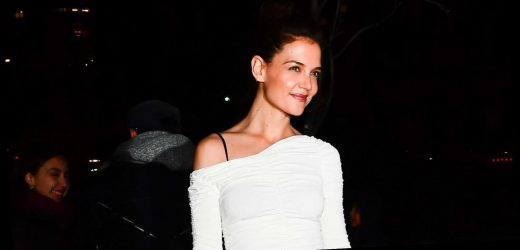 Katie Holmes Sports Winter White with a Sexy, Ruched Dress