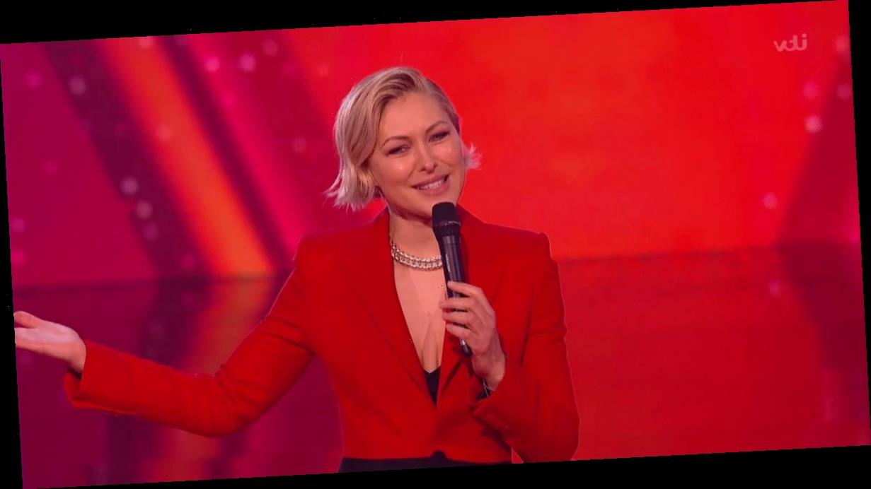 The Voice Kids host Emma Willis turns TV vixen in plunging red suit and heels
