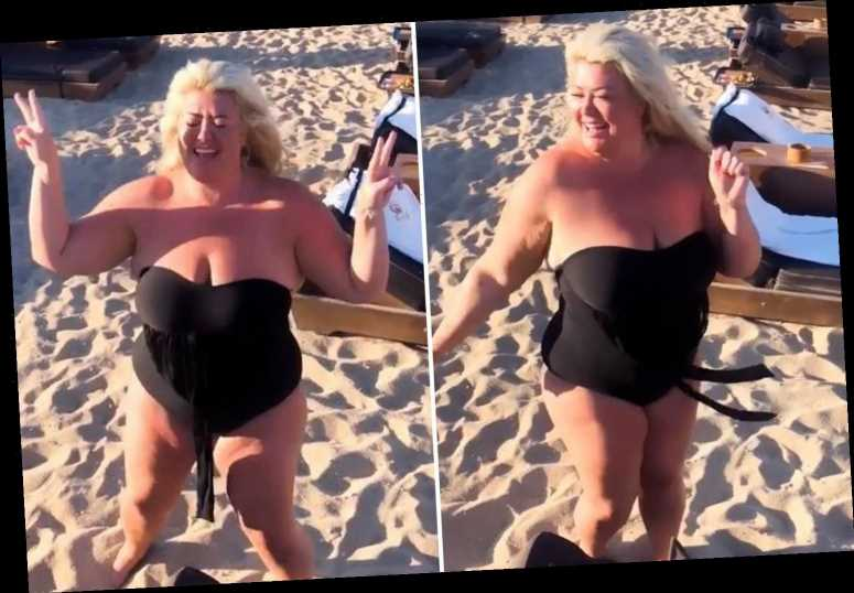 Gemma Collins shows off three-stone weight loss in a strapless black swimsuit on the beach in Mykonos
