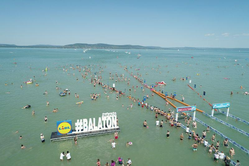 Thousands dive into balmy Lake Balaton in Hungary for swimming contest