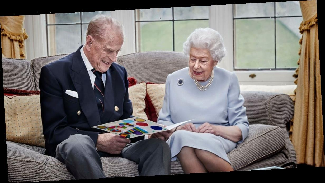 The Queen and Prince Philip beam as they read homemade anniversary card by George, Charlotte and Louis