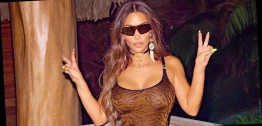 Kim Kardashian goes braless as she flaunts assets in dress for sizzling display
