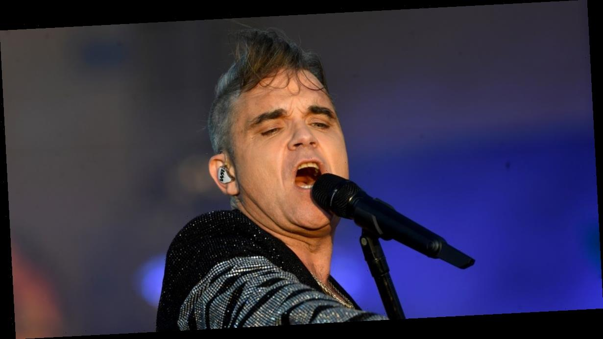 Robbie Williams admits he needs prompter as he can't remember his own lyrics