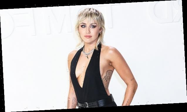 Miley Cyrus Looks Incredible In Low-Cut Tank Top While Makeup-Free In New Photos