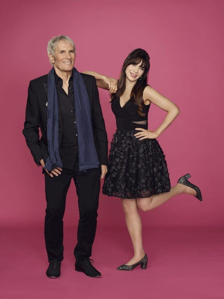 Michael Bolton Sings Zooey Deschanel's Praises as Host of 'The Celebrity Dating Game': 'She's Doing the Heavy Lifting'