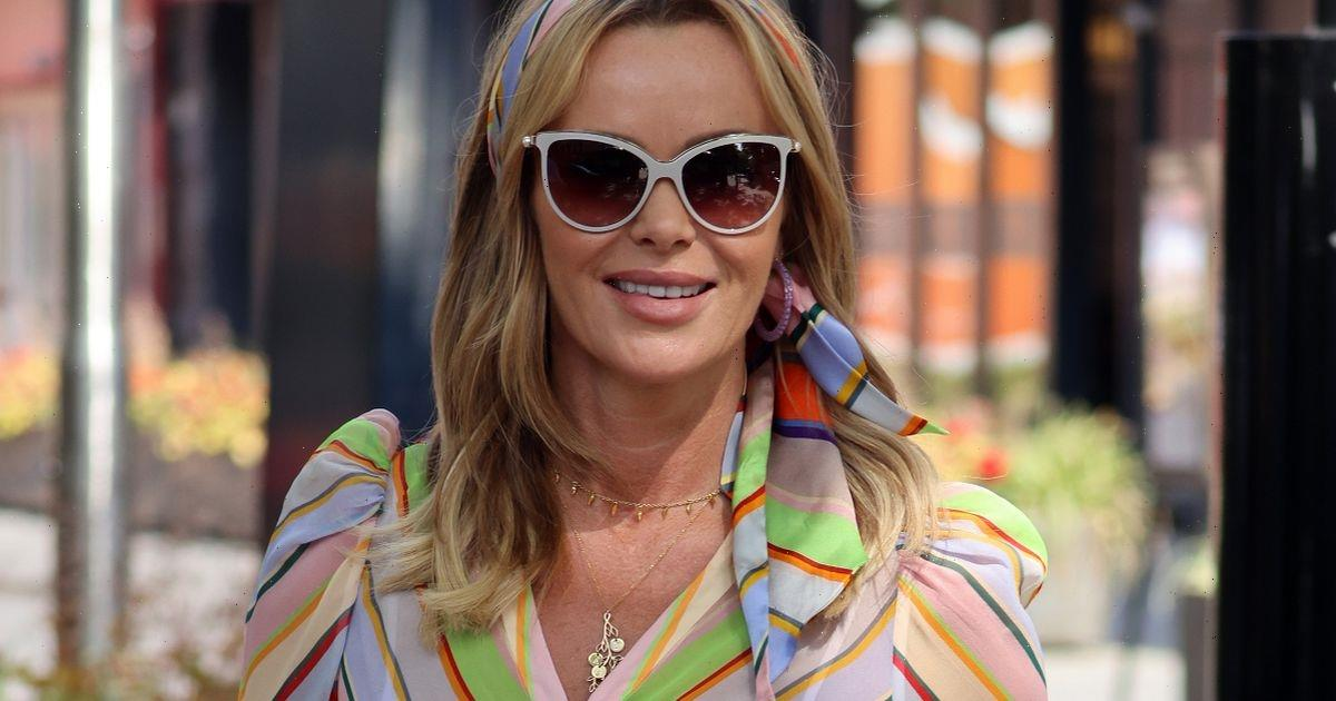 Amanda Holden ditches bra under clingy dress as she soaks up the sun in London